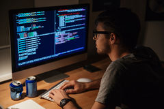 Thoughtful programmer coding in the evening at home Stock Photos