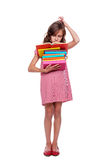 Thoughtful pupil with books Stock Image