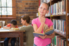 Thoughtful pupil at library Stock Photos