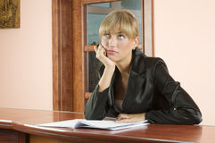 Thoughtful receptionist Royalty Free Stock Photos