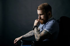 Thoughtful red bearded man studio portrait on dark background Royalty Free Stock Photos