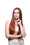 Thoughtful red haired girl Royalty Free Stock Photo