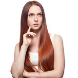 Thoughtful red haired girl Stock Photos