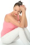 Thoughtful Relaxed Happy Attractive Young Woman Sitting on the Floor Stock Photo
