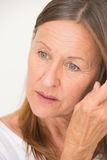 Thoughtful relaxed mature woman portrait Royalty Free Stock Image