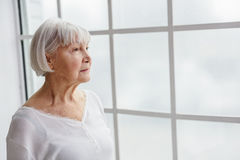 Thoughtful retiree looking what going on Stock Photos