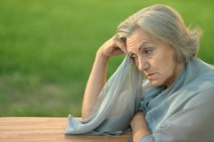 Thoughtful sad elderly woman Stock Photos