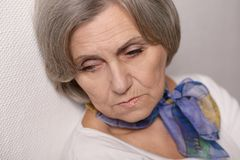 Thoughtful sad elderly woman Stock Photography