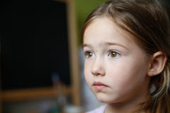Thoughtful and sad little girl Stock Photography