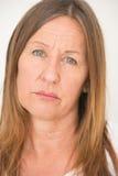 Thoughtful sad mature woman posing Stock Photos