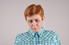 Thoughtful and sad woman Stock Photography