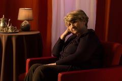 Thoughtful sad woman Stock Photo