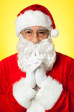 Thoughtful Santa Claus wearing eyeglasses Royalty Free Stock Photography