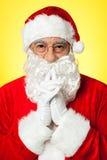 Thoughtful Santa Claus wearing eyeglasses Royalty Free Stock Photography