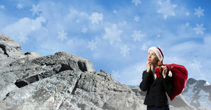 Thoughtful Santa woman Royalty Free Stock Photography