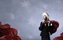 Thoughtful Santa woman Stock Photo