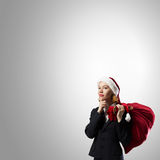Thoughtful Santa woman Stock Image