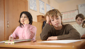 Thoughtful schoolchildren Stock Photo