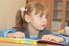 Thoughtful schoolgirl in classroom Royalty Free Stock Images