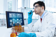 Thoughtful scientist working in the lab Royalty Free Stock Images