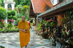 Thoughtful, seemingly indifferent monk in the shrine Royalty Free Stock Photo