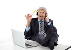 Thoughtful senior business man gets inspired Royalty Free Stock Photography