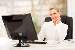 Thoughtful senior businesswoman Stock Image