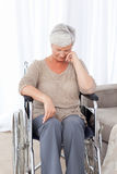 Thoughtful senior in her wheelchair Royalty Free Stock Images