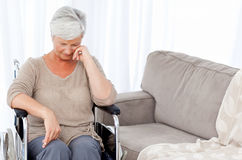 Thoughtful senior in her wheelchair Stock Photo