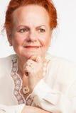 Thoughtful senior lady Stock Image