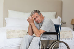 Thoughtful senior man in his wheelchair Royalty Free Stock Image