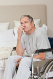 Thoughtful senior man in his wheelchair Stock Photography
