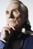Thoughtful Senior Man Wearing Scarf Royalty Free Stock Photography
