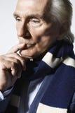 Thoughtful Senior Man Wearing Scarf Royalty Free Stock Photo