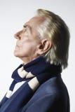 Thoughtful Senior Man Wearing Scarf Royalty Free Stock Photos
