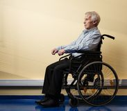 Thoughtful senior man in wheelchair Stock Image