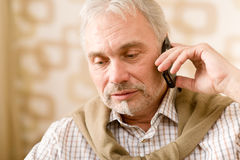 Thoughtful senior mature man with mobile phone Stock Image