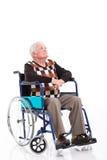 Thoughtful senior wheelchair royalty free stock image