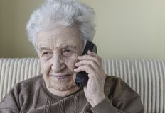 Thoughtful senior woman on phone Stock Image