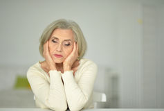 Thoughtful  senior woman Stock Image