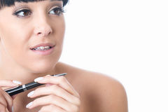 Thoughtful Serious Attractive Young Woman Holding a Pen Royalty Free Stock Photography