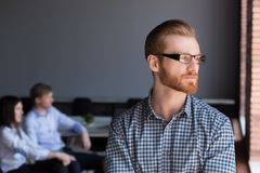 Thoughtful serious businessman looking away thinking of future b. Thoughtful serious businessman ceo or team leader in glasses looking away thinking of future royalty free stock image