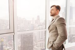 Thoughtful serious businessman working in the office Stock Image