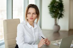Thoughtful serious businesswoman thinking of problem feeling lac stock images