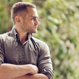Thoughtful serious man outdoors portrait Stock Photo