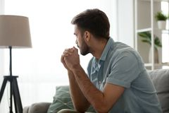 Free Thoughtful Serious Man Sitting On Sofa At Home, Lost In Thoughts Stock Image - 144672701