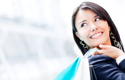 Thoughtful shopping woman Royalty Free Stock Image