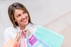 Thoughtful shopping woman Royalty Free Stock Photo
