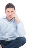 Thoughtful Sitting Man Leaning on his Hand. Close up Thoughtful Businessman Sitting on the Floor and Leaning on his Hand While looking Up. Isolated on a White Stock Photos