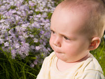 Thoughtful small   baby Royalty Free Stock Images